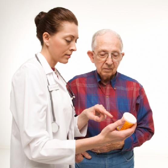 doctor explaing meds to elder